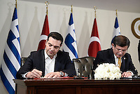 Pictured L-R: Alexis Tsipras and his Turkish counterpart Ahmet Davutoglou signing their agreement Tuesday 08 March 2016<br /> Re: The Prime Ministers of Turkey Ahmet Davutoglu and Greece Alexis Tsipras have met in Smyrna, Turkey to discuss ways to enhance their cooperation as both countries are grappling with an influx of migrants,