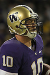 Jake Locker (#10), University of Washington quarterback, scrambles for extra yards during the Huskies Pac-10 conference football game against arch-rival Washington State at Husky Stadium in Seattle, Washington, on November 28, 2009.  Washington shut out the Cougars in their annual Apple Cup battle, 30-0.