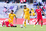 Aziz Behich of Australia (C) runs with the ball as Yousef Rawshdeh of Jordan (L) lies injured on the pitch during the AFC Asian Cup UAE 2019 Group B match between Australia (AUS) and Jordan (JOR) at Hazza Bin Zayed Stadium on 06 January 2019 in Al Ain, United Arab Emirates. Photo by Marcio Rodrigo Machado / Power Sport Images
