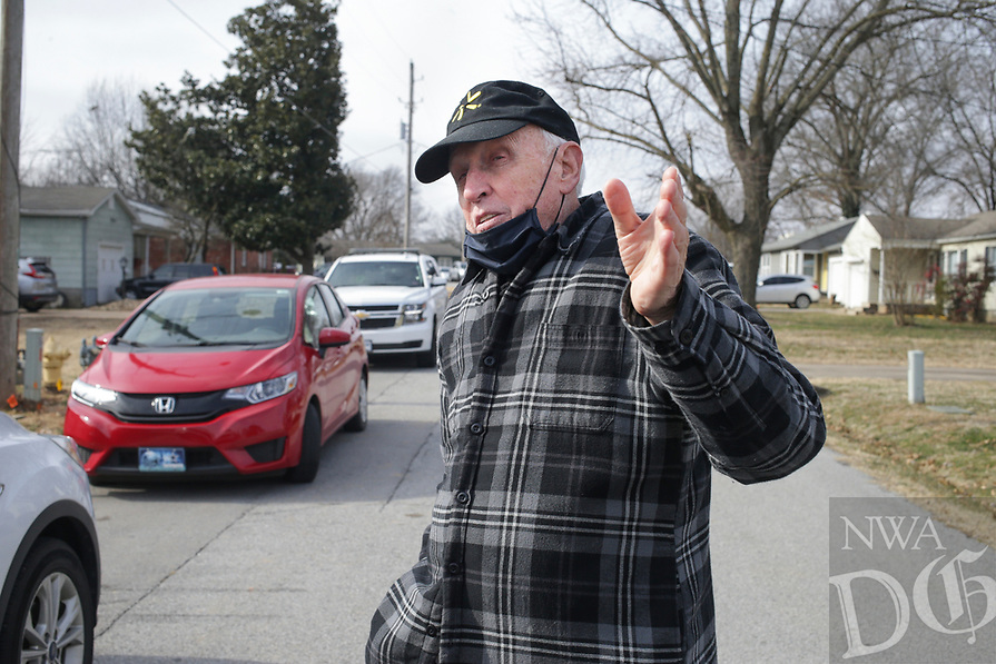 Bob Bennett of Bentonville speaks, Sunday, January 10, 2021 at the 720 NW 6th St. in Bentonville. He said he heard a loud noise from his home around 3 am when police officers shot and killed a man early Sunday morning during a domestic disturbance, according to a news release from the police department. Check out nwaonline.com/210111Daily/ for today's photo gallery. <br /> (NWA Democrat-Gazette/Charlie Kaijo)