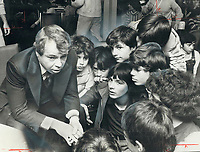1977 FILE PHOTO - ARCHIVES -<br /> <br /> Mayor David Crombie listens attentively as Paul Costa, 12, (not shown) puts forth his debating team's view that Quebec should not separate from Canada. Crombie attended debate at St. Luke Separate School and is shown with (from left at rear) students Peter Reali, Carlos Parra and Tony Marchese and (fore ground) Joe Tavares and Michael Pullella. Costa's team won.<br /> <br /> PHOTO : Ron BULL - Toronto Star Archives - AQP