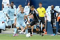 San Jose defender Jason Hernandez (21) moves past Graham Zusi... Sporting Kansas City defeated San Jose Earthquakes 2-1 at LIVESTRONG Sporting Park, Kansas City, Kansas.
