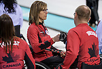 Sochi, RUSSIA - Mar 10 2014 -  Sonja Gaudet fist bumps Dennis Thiessen during Canada vs Norway in Wheelchair Curling round robin play at the 2014 Paralympic Winter Games in Sochi, Russia.  (Photo: Matthew Murnaghan/Canadian Paralympic Committee)