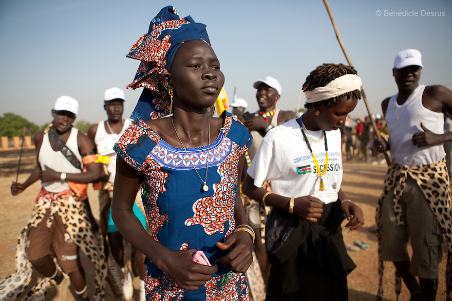 Sunday 9 january 2011 - Juba, Sudan - People from the Dinka tribe from Bor, Jonglei State dance as Southern Sudaneses vote at the John Garang memorial mausoleum where a polling station is being set up in Juba. About four million Southern Sudanese voters began casting their ballots Sunday in a weeklong referendum on independence that is expected to split Africa's largest nation in two. Photo credit: Benedicte Desrus