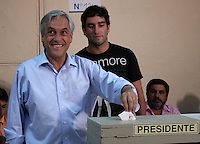 Presidential candidate  Sebastian Pinera,  casts his ballot in a polling station in santiago de chile.  Pinera, a right wing billionaire, won the runoff against Chile ruling coalition candidate Eduardo Frei.