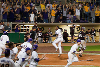 The LSU Tigers erupt from their dugout to celebrate after Arby Fields #9 scores the walk-off winning run in the bottom of the 10th inning against the Mississippi State Bulldogs during the NCAA baseball game on March 16, 2012 at Alex Box Stadium in Baton Rouge, Louisiana. LSU defeated Mississippi State 3-2 in 10 innings. (Andrew Woolley / Four Seam Images)