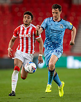 21st April 2021; Bet365 Stadium, Stoke, Staffordshire, England; English Football League Championship Football, Stoke City versus Coventry; Dominic Hyam of Coventry City is chased down by Jacob Brown of Stoke City