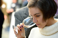 Smelling a glass of wine.