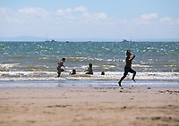 Pictured: Children play in the sea. Saturday 01 July 2017<br />Re: National Wales Air Show in Swansea Bay, Wales, UK.