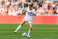 BRIDGEVIEW, IL - JULY 18: Kelcie Hedge #25 of the OL Reign plays the ball during a game between OL Reign and Chicago Red Stars at SeatGeek Stadium on July 18, 2021 in Bridgeview, Illinois.