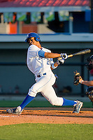 Reggie Taylor #21 of the Burlington Royals takes a big swing against the Kernersville Bulldogs in an exhibition game at Burlington Athletic Stadium June20, 2010, in Burlington, North Carolina.  Photo by Brian Westerholt / Four Seam Images