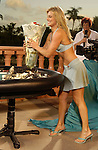 WPT hostess, Courtney Friel, delivers the trophy and cash to the final table.