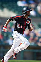 Rochester Red Wings outfielder Aaron Hicks (31) runs to first during a game against the Norfolk Tides on May 3, 2015 at Frontier Field in Rochester, New York.  Rochester defeated Norfolk 7-3.  (Mike Janes/Four Seam Images)