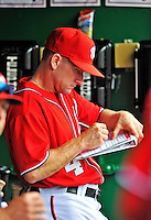 25 September 2011: Washington Nationals hitting coach Rick Eckstein takes notes in the dugout during a game against the Atlanta Braves at Nationals Park in Washington, DC. The Nationals shut out the Braves 3-0 to take the rubber match third game of their 3-game series - the Nationals' final home game for the 2011 season. Mandatory Credit: Ed Wolfstein Photo