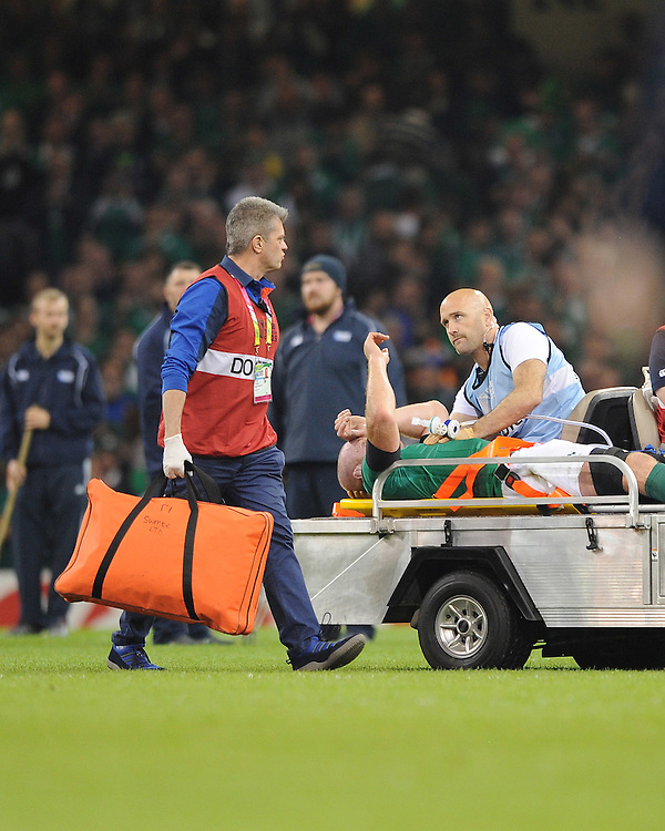 Ireland's medic consults with the match doctor as Paul O'Connell of Ireland is stretchered off at half time during Match 39 of the Rugby World Cup 2015 between France and Ireland - 11/10/2015 - Millennium Stadium, Cardiff<br /> Mandatory Credit: Rob Munro/Stewart Communications