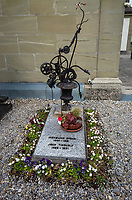 Switzerland. Canton Fribourg. Neyruz. Catholic church. Graveyard. Tombstone of the artist Jean Tinguely and his wife Micheline Gygax ( a photographer). Jean Tinguely (22 May 1925 – 30 August 1991) was a Swiss sculptor. He is best known for his sculptural machines or kinetic art, in the Dada tradition; known officially as metamechanics. Tinguely's art satirized the mindless overproduction of material goods in advanced industrial society. 21.05.2019 © 2019 Didier Ruef