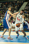 Real Madrid´s Ioannis Bourousis and Anadolu Efes´s Milko Bjelica during 2014-15 Euroleague Basketball match between Real Madrid and Anadolu Efes at Palacio de los Deportes stadium in Madrid, Spain. December 18, 2014. (ALTERPHOTOS/Luis Fernandez)
