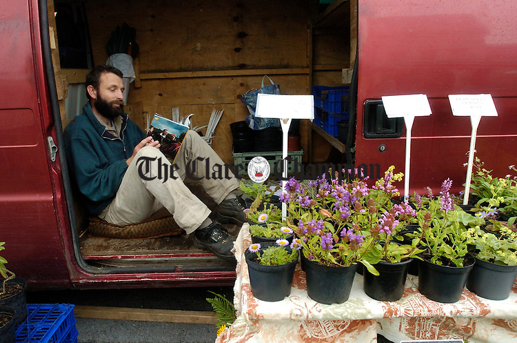 Chris Marsh looks after his stall at the Ennis Farmers Market. Photograph by John Kelly.