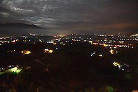 An artistic panoramic view towards south-east of the valley around the small town of Picinisco. It is heart of the night and the moon light seeps in through a cloudy sky, whereas the enlightened street lamps make a light game in the valley. This valley is limited on the left by the Meta Mountains, a part of which emerges from the fog, that make part of the Abruzzo National Park, whereas it expands in the direction of Cassino on the right. <br /> <br /> You can download this file for (E&PU) only, but you can find in the collection the same one available instead for (Adv).