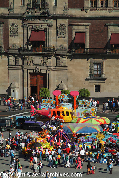 aerial photograph of crowds in the Zocalo, Mexiico City, with the National Palace in the background