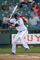 Round Rock Express third baseman Alex Bucholz #5 at bat during the Pacific Coast League baseball game against the Memphis Redbirds on April 24, 2014 at the Dell Diamond in Round Rock, Texas. The Express defeated the Redbirds 6-2. (Andrew Woolley/Four Seam Images)