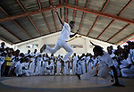 One boy jumps high as children participate in a capoeira program in the Bel Air neighborhood of Port au Prince, Haiti, almost one year after a devastating earthquake. The dance program is sponsored by Viva Rio, a Brazilian organization carrying out community organizing in Port au Prince with support from members of the ACT Alliance.