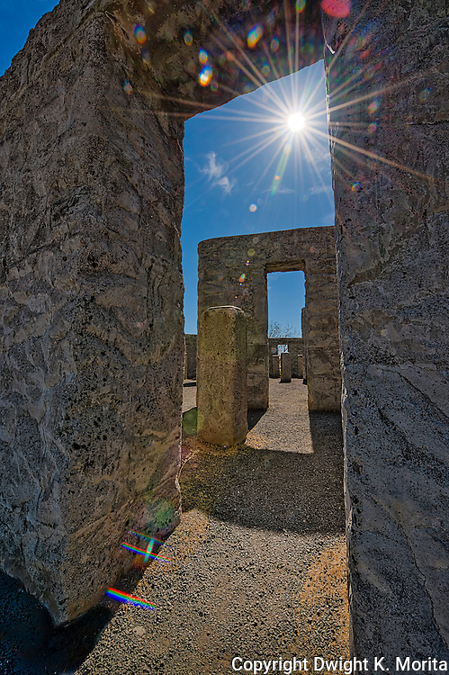 Sunburst shows through the stone passageway at the Stonehenge Memorial in Maryhill, Washington built by Samuel Hill