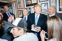 Republican presidential candidate Donald Trump greets people before speaking to reporters at the Red Arrow Diner in Manchester, New Hampshire.