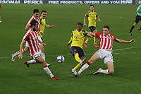 Huddersfield Town's Juninho Bacuna in action with  Stoke City's Harry Souttar<br /> <br /> Photographer Mick Walker/CameraSport<br /> <br /> The EFL Sky Bet Championship - Stoke City v HUddersfield Town - Saturday 21st November 2020 - bet365 Stadium - Stoke<br /> <br /> World Copyright © 2020 CameraSport. All rights reserved. 43 Linden Ave. Countesthorpe. Leicester. England. LE8 5PG - Tel: +44 (0) 116 277 4147 - admin@camerasport.com - www.camerasport.com