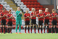 Minute's applause during the English Womens Championship match between Manchester United Women and Leicester City Women at Leigh Sports Village, Leigh, England on 10 March 2019. Photo by James Gill / PRiME Media Images.