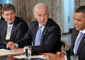 Washington, D.C. - January 4, 2010 -- United States Vice President Joseph Biden, center, makes remarks as he and U.S. President Barack Obama, right, meet with a bipartisan group of Governors from across the country in the State Dining Room to discuss energy policy in Washington, D.C. on Wednesday, February 3, 2010. At left is Governor Joe Manchin (Democrat of West Virginia), Vice Chair, National Governors Association (NGA)..Credit: Ron Sachs / Pool via CNP