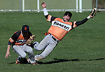 Somerville at Rutgers Prep baseball photographed on Tuesday April 5, 2016.<br /> Somerville's # 21-Preston Scott  (right) has the ball go off his glove as he collides with team mate # 12  Ethan Lott (left) as both when to try for a pop up hit by Rutgers Prep's # 19 Danny Schantz (not seen)