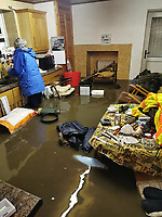 Pictured: Interior view of the flooded cottage in Quaker's Yard, Wales, UK. Sunday 16 February 2020<br /> Re: A cottage on the bank of the River Taff at Quaker's Yard, Merthyr Tydfil, was flooded out because of storm Dennis, forcing the 84 year old Brian Owen upstairs. Water levels went down at daylight leaving living room furniture bobbing around in brown sludge.