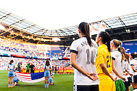 United States (USA) players during the playing of the national anthem. The women's national team of the United States defeated the Korea Republic 5-0 during an international friendly at Red Bull Arena in Harrison, NJ, on June 20, 2013.