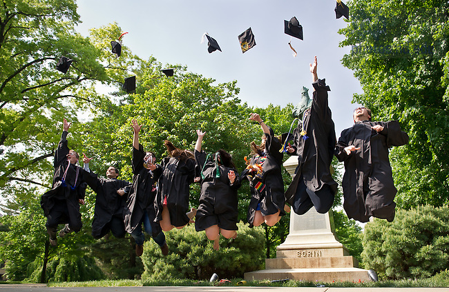 May 19, 2013;  Graduates jump and throw their caps in the air after the 2013 Commencement...Photo by Matt Cashore/University of Notre Dame