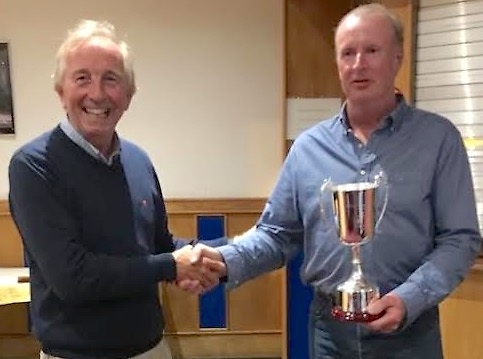 The Glenarm Sailing Challenge's Denis Todd (left)) presents the trophy to David Eccles