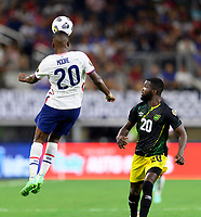 DALLAS, TX - JULY 25: Shaq Moore #20 of the United States goes up for a header as Kemar Lawrence #20 of Jamaica looks on during a game between Jamaica and USMNT at AT&T Stadium on July 25, 2021 in Dallas, Texas.