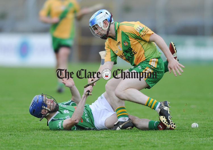 Alfie Rogers of Scariff in action against Sean O Gorman of O Callaghan's Mills during their game in Cusack Park. Photograph by John Kelly.