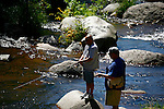 Fisherman fishes in stream<br /> (3)