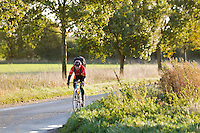 18 OCT 2011 - NORFOLK, GBR - Iain Dawson cycles the short distance to work. Although unable to distinguish details and read road signs the better light during the summer months means he is able to make out shapes along his route that he can recognise and use to know when to take a turn (PHOTO (C) NIGEL FARROW)