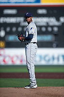 Tri-City Dust Devils starting pitcher Manny Guzman (49) gets ready to deliver a pitch during a Northwest League game against the Everett AquaSox at Everett Memorial Stadium on September 3, 2018 in Everett, Washington. The Everett AquaSox defeated the Tri-City Dust Devils by a score of 8-3. (Zachary Lucy/Four Seam Images)