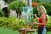 Resident artist Kat Sowa paining the ruins on the property at Caneel Bay<br /> St John, US Virgin Islands