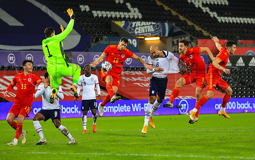 12th November 2020; Liberty Stadium, Swansea, Glamorgan, Wales; International Football Friendly; Wales versus United States of America; John Brooks of USA heads at goal while under pressure from Tom Lockyer and James Lawrence of Wales as Keeper Ward comes out to save