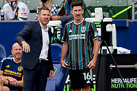 CARSON, CA - APRIL 25: Los Angeles Galaxy head coach Greg Vanney giving directions to his pupil Sacha Kljestan #16 before he enters the field during a game between New York Red Bulls and Los Angeles Galaxy at Dignity Health Sports Park on April 25, 2021 in Carson, California.