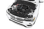 Car Stock 2017 BMW X4 xDrive28i 5 Door SUV Engine  high angle detail view