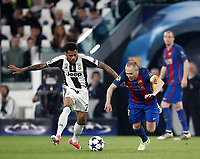 Football Soccer: UEFA Champions UEFA Champions League quarter final first leg Juventus-Barcellona, Juventus stadium, Turin, Italy, April 11, 2017. <br /> Juventus Dani Alves (l) in action with Barcellona Andrés Iniesta (r) during the Uefa Champions League football match between Juventus and Barcelona at the Juventus stadium, on April 11 ,2017.<br /> UPDATE IMAGES PRESS/Isabella Bonotto