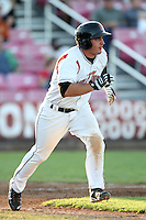 Salem-Keizer Volcanoes designated hitter Mike Murray #25 runs to first base against the Spokane Indians at Volcanoes Stadium on August 10, 2011 in Salem-Keizer,Oregon. Salem-Keizer defeated Spokane 7-6.(Larry Goren/Four Seam Images)