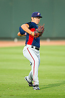 Potomac Nationals starting pitcher Matt Purke (38) warms up in the outfield prior to the game against the Winston-Salem Dash at BB&T Ballpark on July 8, 2013 in Winston-Salem, North Carolina.  The Dash defeated the Nationals 12-9.  (Brian Westerholt/Four Seam Images)