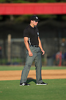 Umpire Dillon Wilson handles the calls on the bases during the Appalachian League game between the Kingsport Mets and the Danville Braves at American Legion Post 325 Field on July 9, 2016 in Danville, Virginia.  The Mets defeated the Braves 10-8.  (Brian Westerholt/Four Seam Images)