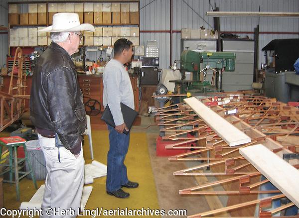 Pilot and aircraft builder Lauren William shows Dave Ruiz the status of his current aircraft construction project in his hangar at the Petaluma Municipal Airport, Petaluma, Sonoma County, California.